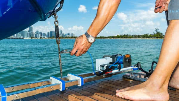 Hurley Marine dinghy davit being used to lift boat from water